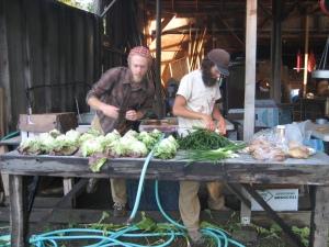 Jon & Josh washing veggies for market